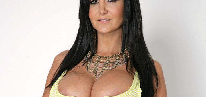 Ava Addams showing off deep cleavage in tight yellow dress