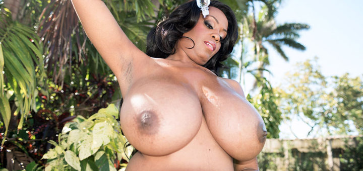 Big tits ebony babe naked outdoors oiling her brown boobs