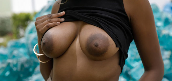 Big brown tits flashed outdoors
