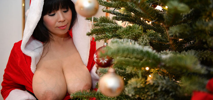 Busty Asian babe in Xmas costume with big boobs hanging out