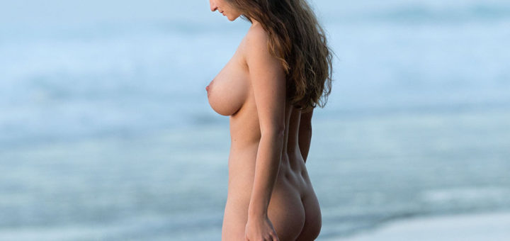 Susann at the seaside beautifully naked with large breasts and stunning nude body
