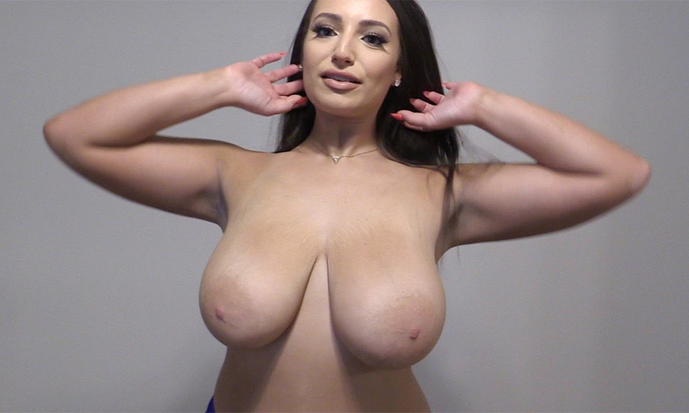 Curvy brunette with big boobs topless
