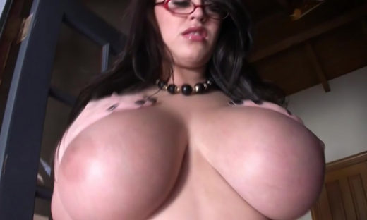 Big boobs brunette wearing glasses seen from low angle