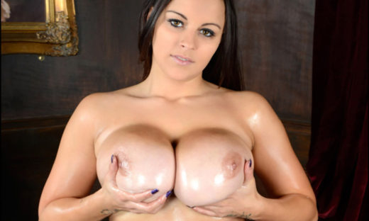 Busty brunette cupping big tits oiled