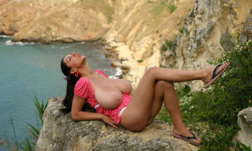 Very busty babe topless on cliffs