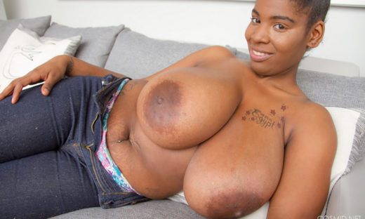 Big boobed ebony babe topless in blue jeans
